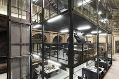 This 16th Century Baroque church turned architecture studio is a perfect blend of new and old. The shell of the church is intact but Italian architect Massimiliano Locatelli has created a tiered glass and metal office space within.