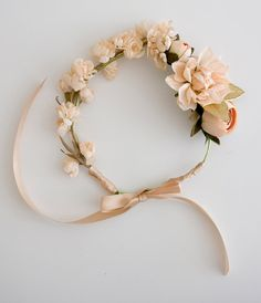This soft pink n peach floral crown is PERFECT for that sweet little lady in your life. The crown is made of floral wire and faux florals.