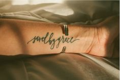 Saved by Grace Custom Calligraphy Tattoo Design - Arm I love this
