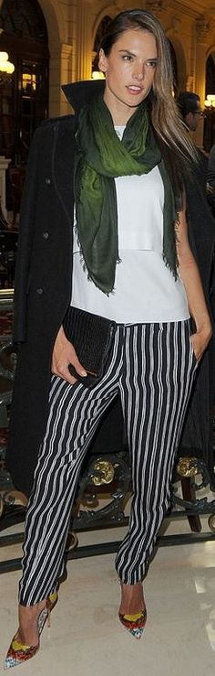 Who made  Alessandra Ambrosio's black stripe pants and white top?