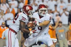 Sep 12, 2015; Knoxville, TN, USA; Oklahoma Sooners quarterback Baker Mayfield (6) hands off to running back Samaje Perine (32) during the second half against the Tennessee Volunteers at Neyland Stadium. Oklahoma won 31-24. Mandatory Credit: Jim Brown-USA TODAY Sports