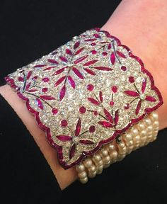 A Belle Epoque natural pearl, ruby and diamond bracelet, circa 1910.