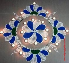50 Small Rangoli Design (ideas) that you can make yourself or get it made during any occasion on the living room or courtyard floors. Easy Rangoli Patterns, Rangoli Designs Peacock, Rangoli Designs Latest, Simple Rangoli Designs Images, Rangoli Ideas, Rangoli Designs Diwali, Rangoli Designs With Dots, Beautiful Rangoli Designs, Rangoli Photos
