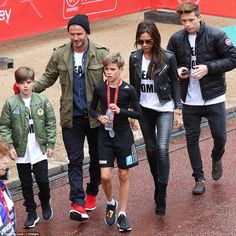 David and Victoria Beckham were in the crowd with sons Cruz (far left) and Brooklyn (right...