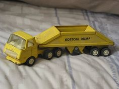 A Junkee Shoppe Junk Market Stop: TONKA Bottom Dump Pressed Steel Truck Toy Vehicle ... For Sale Click Link Here To View >>>> http://ajunkeeshoppe.blogspot.com/2015/12/tonka-bottom-dump-pressed-steel-truck.html