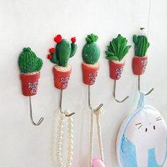 Super cute succulent key hooks.