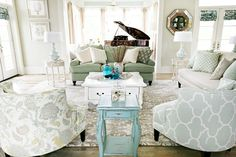 swap the color palette with pink and I have died and gone to heaven. love the round accent chairs and mix of fabrics.