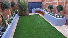 Cedar screen topiary fake grass formal privacy fence London Chelsea design Fulham garden modern Streatham