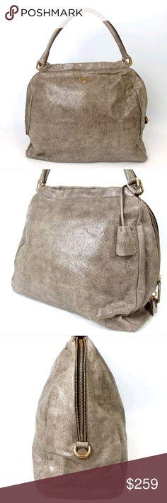 Spotted while shopping on Poshmark  HUGE Prada cracked leather handbag! 95db37bd16