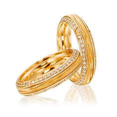 Cellini Jewelers 'Genuine Delight, Blissful Love' Ring by Wellendorff  'Genuine Delight, 'Blissful Love' spinning band ring, in 18-karat yellow gold with two rows of brilliant diamonds. Handcrafted with central, spinning row of ribbed, 18-karat gold.