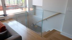 Beautiful Glass Stair Railing Design Examples To Inspire You : U-shaped Stair With Glass Railing And Wooden Handrails From Caliper Studio