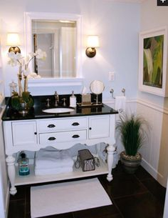 I like how it looks modern with the granite top but still has the cute details on the bottom and with an added shelf