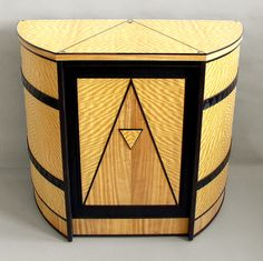 curved-cabinet with the art deco design. Just beautiful