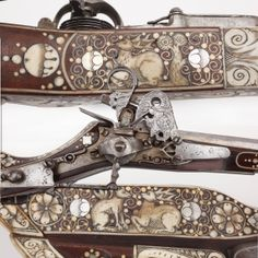 "Engraved Wheellock Rifle- One of our earliest pieces on display in our ""Old Guns in a New World"" gallery is this wheellock rifle. While nicely engraved, we'll call your attention specifically to the many inlays of animals that appear in bone and ivory over the stock's surface.  Geometric accents segregate the animal aspects of the adornment for this muzzleloading rifle, but the intricate scrimshaw and carving work necessary to complete each of these figures is truly a marvel in miniature."