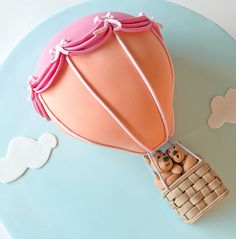 Love the idea of a hot air balloon cake! Just with more details on the balloon and no teddy bears.