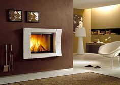 Piazzetta's stylish ME 70/51 with Academy Surround. Calore Fireplaces are proud importers of Piazzetta products made in Italy. Visit www.calore.co.za to see more of our stunning fireplaces.