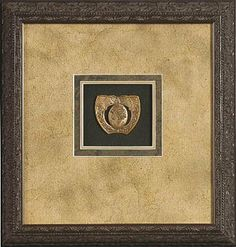 Think big! Four layers of mat with extra wide borders help this small object to shine. #customframe #pictureframe #framedesign