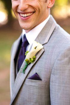 grey suit and purple tie.