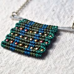 macrame pendenant -   A new technique in jewelry I haven't seen before. Very modern and textural, with a nod to the art of macrame.