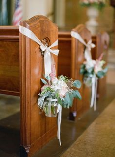 Church Pew Decor -- See the wedding on SMP here: http://www.StyleMePretty.com/2014/06/03/timeless-austin-wedding-at-chateau-bellevue/  Photography: TaylorLord.com -- Floral Design: PetalPushers.us