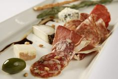 Romanian Appetizer Spread of Salami, Sausages and Cheeses - Mezeluri