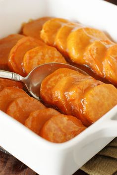 Glazed Sweet Potato Coins ~ Sweet potatos bathed in brown sugar-butter glaze are the perfect addition to any Thanksgivng, Christmas, or Fall dinner.  And these have a little secret ingredient to keep the glaze from being overly sweet!  #sweetpotatoes #sweetpotatocasserole #Thanksgiving #glutenfree #glutenfreeThanksgiving www.thekitchenismyplayground.com