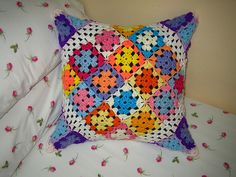 """Interesting twist on the granny square pillow!  Make one giant square (made of little squares), fold it around the pillow """"on point"""", and crochet/sew it shut."""
