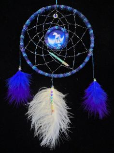 Unicorn Dreamcatcher Designed and Hand Made with Love by Rowan Duxbury. Find me on my : 'Positively Pagan Crafts ' Facebook page.
