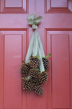 Pine cone door decor...Pretty cute and cheap for fall!  I hot glued the pine cones to the ribbon.  Had to fix a few that fell off every once in a while, but overall not a bad project, considering how close to free it was.