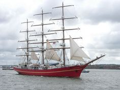 The KHERSONES (Russian: Херсонес) is a Ukrainian three-mast tall ship, a full rigged ship. She is seen here on the River Mersey on June 12, 2005 during the Mersey River Festival Parade of Sail.   The ship was built in 1989 in Gdańsk Shipyard, Poland, in a series of six sister ships (among which also the Mir), after the designs of Zygmunt Choreń. The ship is named after the city of Kherson on the North coast of the Black Sea.