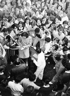 Judy Garland signing autographs at a school in Miami, Florida, 1938