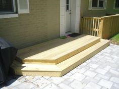 These wooden steps are the perfect way to to transition from the doorway to the stone patio. Repin if this looks like a welcoming backyard! | Washington DC Area | Johnson's Landscaping Service #landscaping