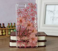 This is Real Dried Flower and Leafs on the back of your case.    The back is covered by hard resin :)
