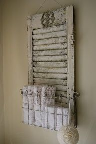 Shabby chic single shutter up cycled into bathroom towel and accessory holder