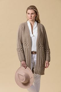 Newton's textured cardigan, heavenly in Jo Sharp's Silkroad Ultra, features horizontal cables knit side to side before the upper fronts and back are picked up from one edge of the cables and worked up. Stitches for the lower fronts and back are then picked up along the other cable edges and worked down. The sleeves are worked both up and down from either edge of the horizontal cables.