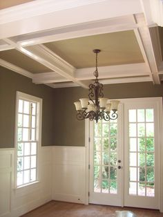 Beautiful Coffered ceiling with alternate size and shape, wall panels, trim casing. Work done by Woodmaster Woodworks.