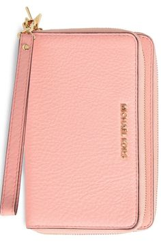 Obsessed with this Michael Kors pink wristlet. A pebbled leather wallet makes organization a breeze with dual interior compartments to keep track of your cards, cash, smartphone and more
