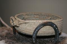 Great centerpiece. Yahoo! Western Cowboy Lariat Rope Basket with Horseshoes $75.00 USD, via Etsy.