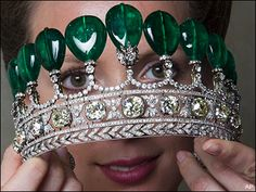 """An extremely rare emerald and diamond tiara, ca. 1900, during a preview at Sotheby's in Geneva, Switzerland. Sotheby's said that the tiara once belonging to the Duchess of Windsor Wallis Simpson was auctioned for US $12.7 million on Tuesday, May 17, 2011. Are these the emeralds the Duke """"borrowed"""" when he was exiled from England?"""