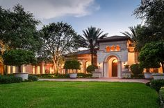 Truly a masterpiece of architectural design, this sprawling one-story 7 Bedroom, 8 full & 2 half bath 10,652 SF Custom Estate home with air-conditioned garages for up to 7 cars sits on an incredible 5-acre lakefront lot in a gated private estate home community with the utmost of security and convenience.
