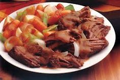 Golden Corral Pot Roast    cut of boneless chuck roast. put in roasting pan, cover with 2 cans of cream of chicken soup and 1 envelope of lipton beefy onion dry soup mix. surround roast with carrots, onions, chunks of potatoes, stalks of celery. cover tightly with lid, or foil. cook in oven for 3 hours @ 350. or 8 hours on low heat in crock pot. remove meat,  veggies, place on platter. mix 3 tb corn starch with  2tb cold water, mix into broth, stir for 1 minute to thicken and make gravy.