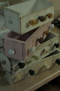 On of our first creations - antique sewing table drawers flipped into shelves and jewelry holders.so pretty!