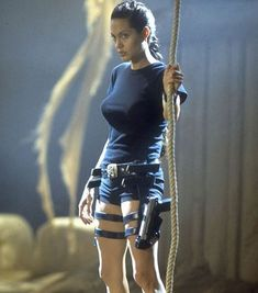 "Angelina Jolie as Lara Croft in ""Tomb Raider"" and ""Tomb Raider II: Cradle of Life"" Pretty much Angelina Jolie in everything she does. Tomb Raider Angelina Jolie, Lara Croft Angelina Jolie, Angelina Jolie Young, Tomb Raider Costume, Tomb Raider Movie, Tomb Raider 2001, Kate Middleton, Beyonce, Laura Croft"