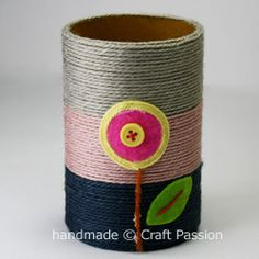 pencil, crayon, etc holder from paper tube and yarn, glue yarn on and embellish as desired