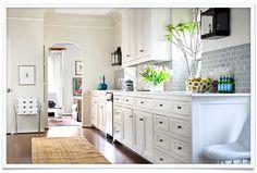 White kitchen, wood floors