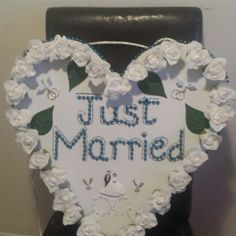 white and blue writing wedding sign