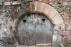 rock architecture building wall arch wooden door ruins monastery old door heart shapes ancient history ancient door with hearts arched doorway ancient entrance