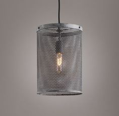 RH baby&child's Fordson Steel Medium Pendant:Perforated steel is renowned in industrial settings for its high strength-to-weight ratio. It also boasts a unique aesthetic, as evidenced by our collection, which exhibits a sleek, machine-age modernism and a gentle, filtered glow.