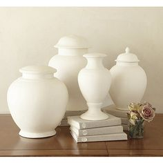 above kitchen cabinets...to add a touch of white...all white accents to marry kitchen and sunroom...Suzanne Kasler French Bisque Lamp Slips