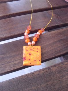 handmade neckless with polymer clay-pendant and different pearls!